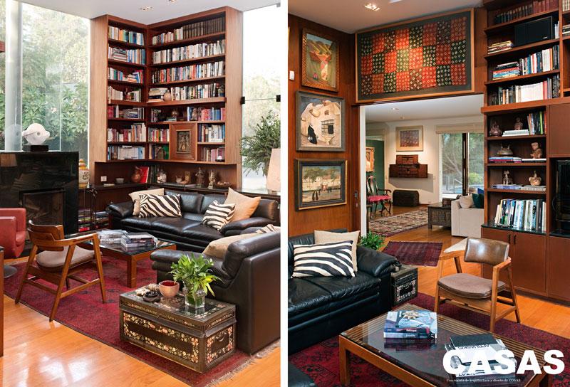 Biblioteca de la casa, lugar de encuentro de la familia, con telar Wari, huacos entre los libros y, a la izquierda, obras de Enrique Camino Brent y Camilo Blas.