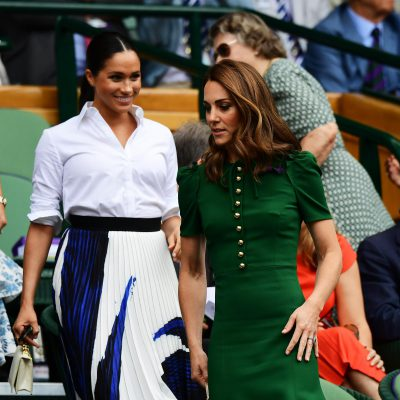 Kate Middleton and Meghan Markle attend the Royal Box during Day twelve of The Championships
